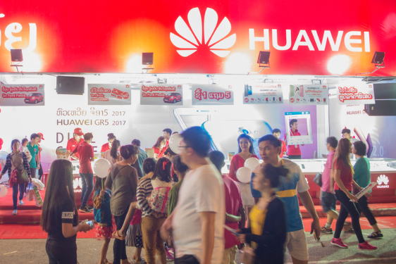 Crowd in the background of Huawei logoHuawei