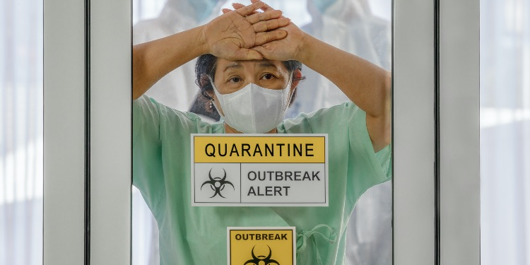 coronavirus covid 19 infected patient in coronavirus covid 19 quarantine room with quarantine and outbreak alert sign at hospital with blurred disease control experts